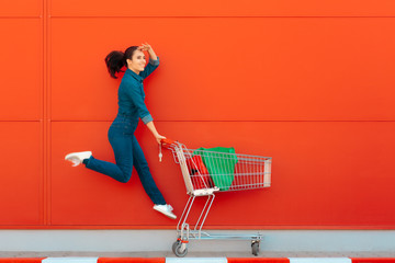 Happy Woman with Shopping Jumping with Joy
