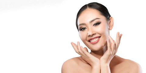 Beauty shot of young pretty asian woman with clear skin ongrey background, for skin ad and cosmetology