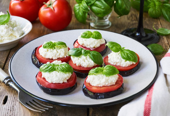 Fried eggplants with tomatoes and cottage cheese