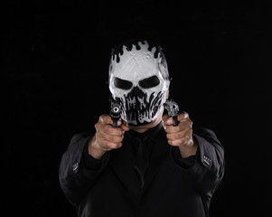 man in a black mask with a gun