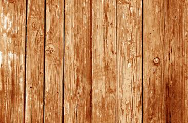 Old grunge wooden fence pattern in orange tone.