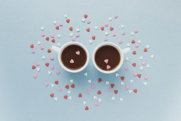 Two cups of coffee with a lot of sugar hearts. Blue pastel background. Love concept. Valentine, marriage morning tea coffee. Blue pastel background. Vintage style