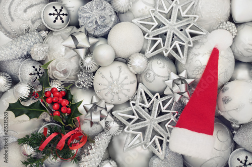 3e44e6922574 Christmas background with white and silver baubles, santa hat and holly and  fir decorations. Traditional christmas greeting card for the holiday  season. Top ...