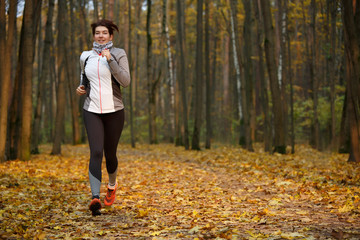 Full-length photo of athlete woman on morning run