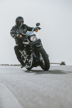 Close up of motorcycle turning on the road asphalt.