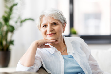 mature age and people concept - portrait of happy senior woman at home