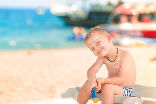 Cute little boy with sunscreen on
