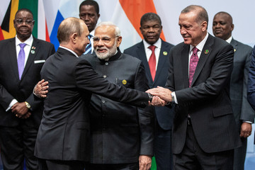 Russian President Vladimir Putin, Indian Prime Minister Narendra Modi and Turkish President Tayyip Erdogan interact before a group picture at the BRICS summit meeting in Johannesburg