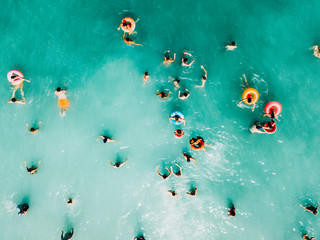 Aerial Summer View Of Clear Ocean Water Full Of Tourists