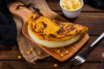 Cachapa with cheese, typical Venezuelan dish made with corn, cheese and butter