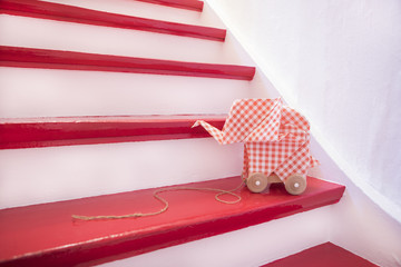 Stairs with origami elefant