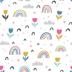 Hand drawn cute abstract pattern. Rainbow, flower, clouds doodle vector seamless background. Design for fabric in bright colors.