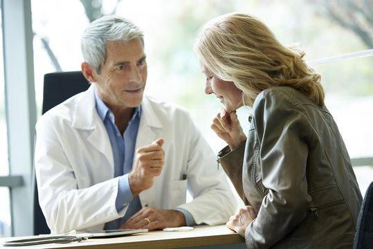 Doctor encouraging his patient