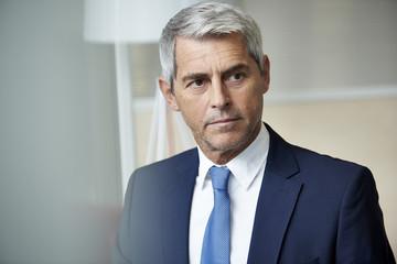 Close-up of businessman looking away