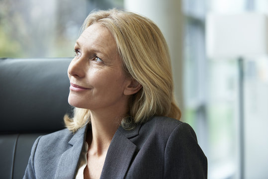 Close-up of businesswoman looking away