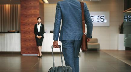 Business traveler arriving at hotel