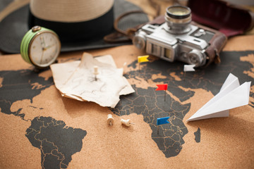 old camera and route plan on the map, vintage photo. Travel and holidays. Copy space.