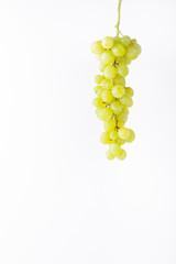 Green grapes on white background minimalism