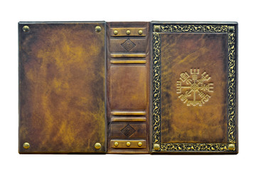 Leather book with the Vegvisir, ancient Icelandic magical symbol. The book is captured opened and frontal while stand up on the table