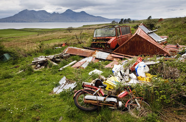 Discarded farm equipment mars the beautiful landscape on the Isle of Eigg