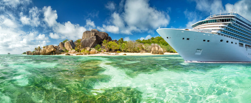 Luxury cruise boat with tropical Seychelles island