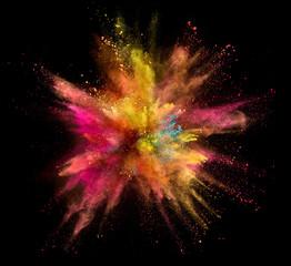 Coloured powder explosion isolated on black background