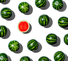 One out unique watermelons arranged on a white background