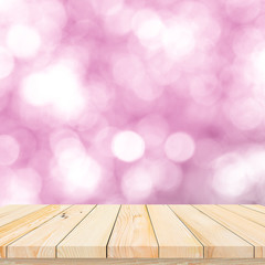 Wood table or wood floor with abstract pink bokeh background for product display