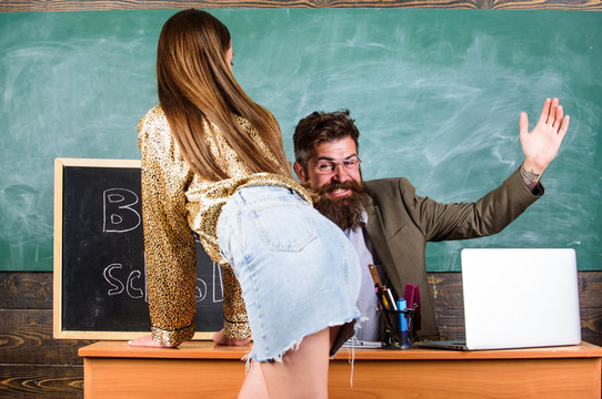 Role game concept. School behaviour discipline and punishment. Teacher or school principal punishes slapping buttocks sexy girl student. Student in mini skirt with sexy buttocks waits for punishment