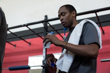 Man drinking water from water bottle