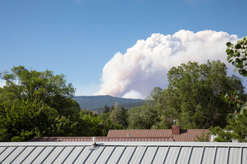 Smoke from the 416 forest fire over rooftops in downtown Durango, Colorado