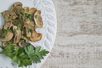 Mushrooms cooked in olive oil, parsley and garlic.
