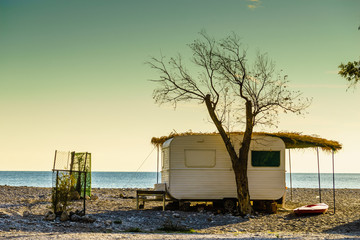 Caravan trailer on sunny beach