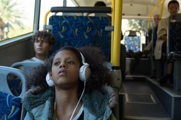 Teenage girl listening music on headphones