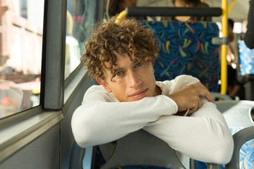 Young man travelling in the bus