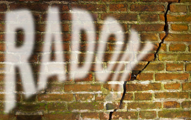 A cracked brick wall with radon gas escaping - concept image with copy space