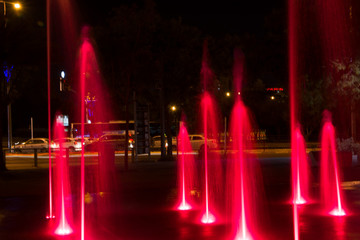 Fountain colored water show. Colorful fontain light in city
