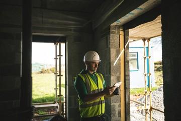 Engineer using digital tablet inside the building under
