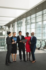 Group of happy businesspeople interacting with eachother