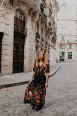 ginger oman wearing a floral dress in the streets of paris