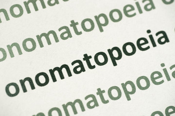word onomatopoeia printed on paper macro