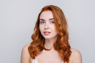 Studio Portrait Of Beautiful Redhead Girl