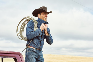Cowboy with a rope over his shoulding