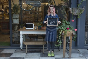 Barista standing with a open signboard