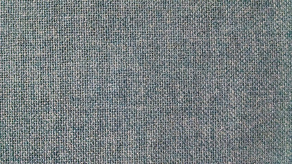 Blue fabric of an office cubicle wall, background texture.