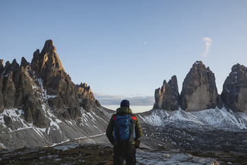 Man observing the peaks of Tre Cime di Lavaredo, Dolomites