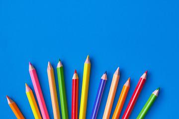 Color pencils on a blue background.