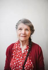 Portrait of content senior woman on plain white background
