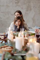 Thoughtful girl on family dinner