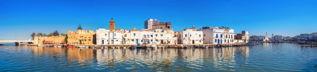 Canvas Prints Tunisia Waterfront panorama with picturesque houses and wall of kasbah at old port in Bizerte. Tunisia